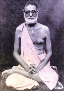srila_bhaktisiddhanta_sitting_cross-legged