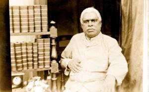 Bhaktivinoda Thakura with books